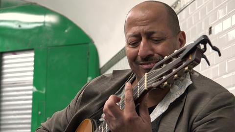 Guitarist playing in the subway underground passage. Paris. 4K Footage