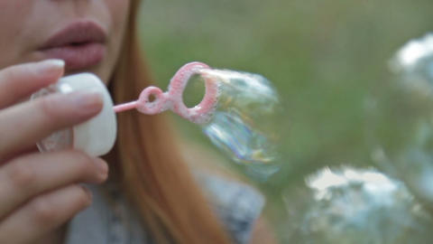 Fashion girl blowing bubbles in the wind Footage