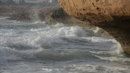 Waves splashing on cliffs and against each other Footage