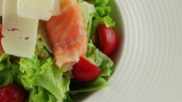 salmon carpaccio with cheese salad mix in white plate Footage