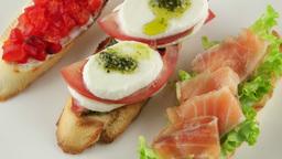 Italian bruschetta set (mini sandwich) with tomato, mozzarella and salmon Footage
