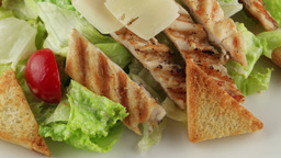 Caesar salad with grilled chicken closeup Footage