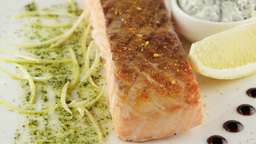 grilled salmon with lemon and sour cream sauce, closeup Footage