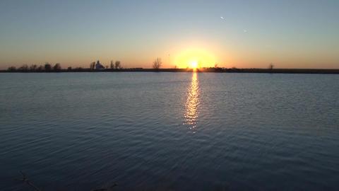Slow Pan Across Lake Sunset Footage