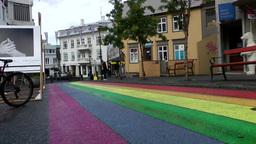 Iceland Reykjavik 065 rainbow colors on asphalt of downtown street Footage