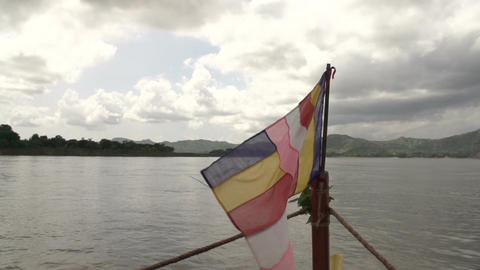 Buddha flag on front of boat Live Action