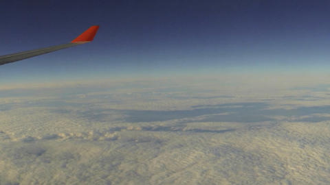 The Airplane Is Flying Above The Clouds Footage
