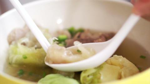 eating Chinese food, wonton dumpling soup Footage