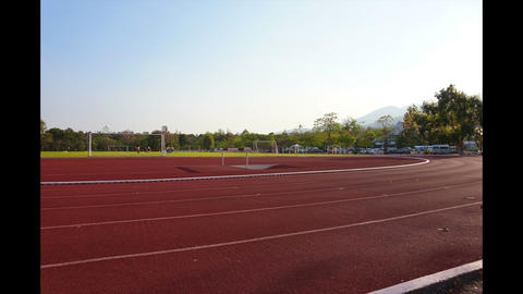 Time-lapse, Joggers On Running Track In Sunny Day stock footage