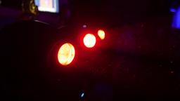 Red turning searchlights in nightclub. Spotlights Footage