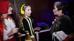 Three girls in costumes dance at halloween party. Little Red Riding Hood. Dj Footage