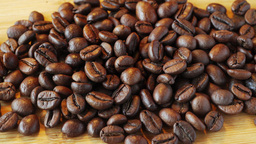 Coffee Beans On Wooden Background. Close Up stock footage