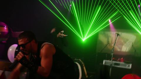 Rap artist perform on stage at Halloween party in nightclub. Pumkins. Laser show Footage