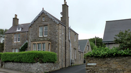 Scotland Orkney Islands Kirkwall 022 Grey Residential House With Driveway Betwee stock footage