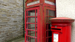Scotland Orkney Islands Kirkwall 029 red British telephone box and mailbox Footage
