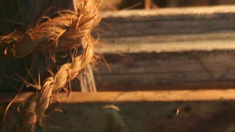 Rough And Course Rope And Worn Wood With Warm Lighting stock footage