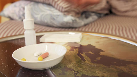 Hand is taking pharmaceutical pill from plate Footage
