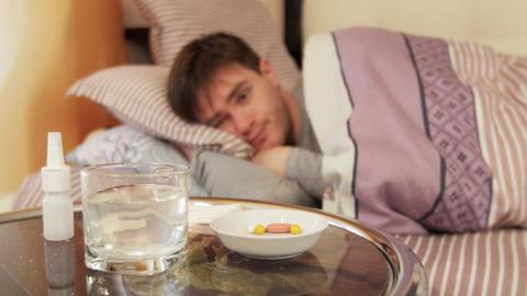 Ill man sleeping in bedroom Footage