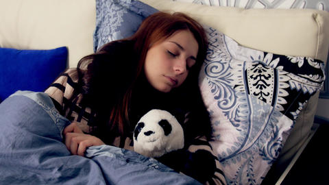 Ill young woman sleeping in bed with panda toy Footage