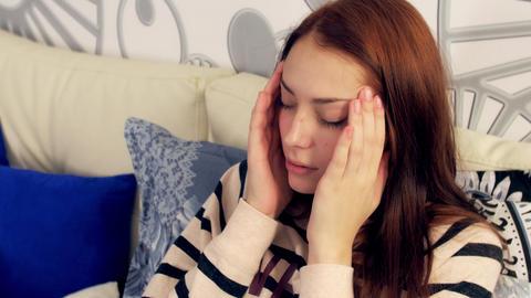 Redhead woman in bed suffering headache Footage