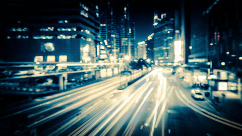 Abstract blurred video of night city traffic. Time lapse. Hong Kong Footage