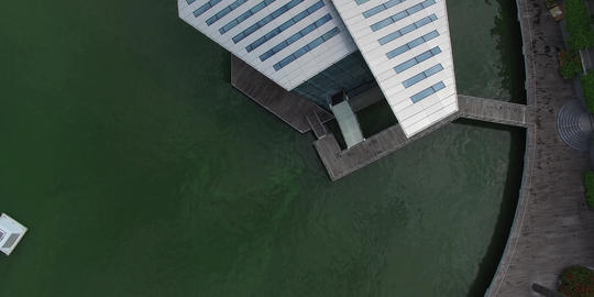 descending birds eye over louis vutton marina bay 2 Footage