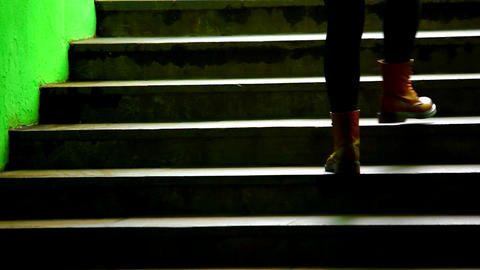 1080p Woman on Dark Green Subway Staircase Footage