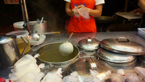 Soybean milk boiling and selling in Asian stall market Footage