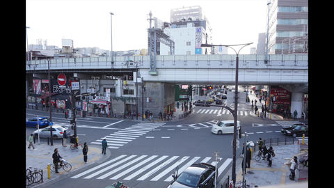 OSAKA, JAPAN - MARCH 2015: -Time Lapse, Aerial View of Pedestrians Crossing Cros Footage