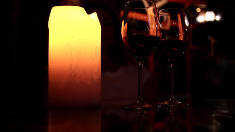 Two glasses of wine in the candlelight Live Action