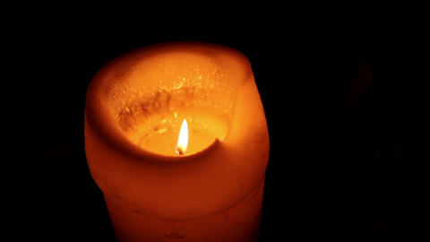 Candle burning in the dark Footage