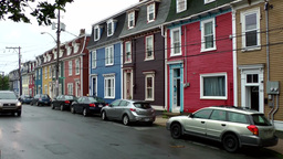 Canada Newfoundland St. John's 033 colorful houses in street with wet asphalt Footage