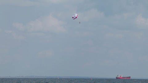 People fly on a parachute over the water Footage