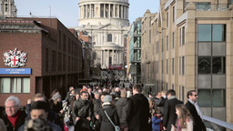 People walk over Millenium Bridge Twelve Footage