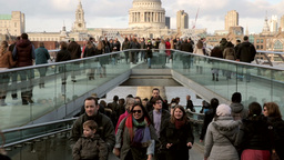 People walk over Millenium Bridge Two Footage