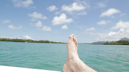 Persons Leg On Boat Near Island stock footage