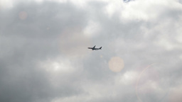 Plane Flies By On A Cloudy Sky stock footage