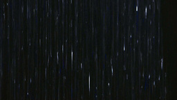 Rain falling down with black background Footage