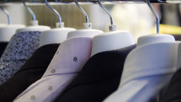 Suits On Rack Fashion Shop stock footage