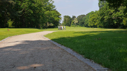 Three Golf Player Walking Down The Sand Path To The Next Hole stock footage
