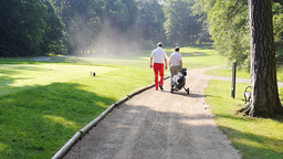 Two Men Walking Down A Sand Path To The Next Hole stock footage