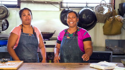two women cooking in outdoor kitchen in mauritius two C Footage