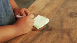 Woman Writing Down Shopping List In Mauritius stock footage