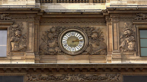 Clock in facade of Louvre Museum in Paris. France. 4K Stock Video Footage