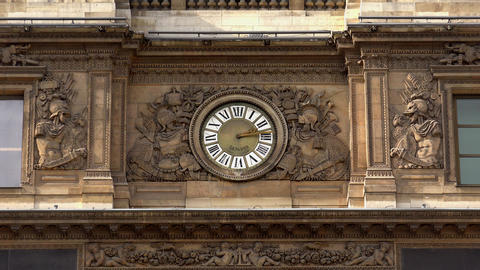 Clock in facade of Louvre Museum in Paris. France. 4K Live Action