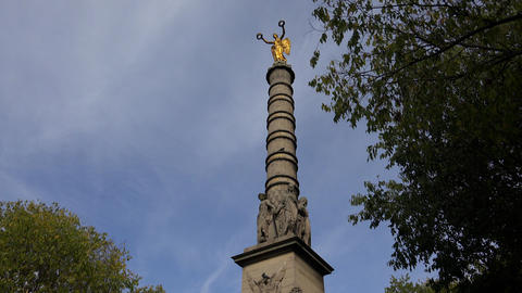 Colonne on the place in Paris. Golden statue. France. 4K Footage