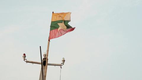 Ayeyarwady river, flag from Myanmar, Burma Footage