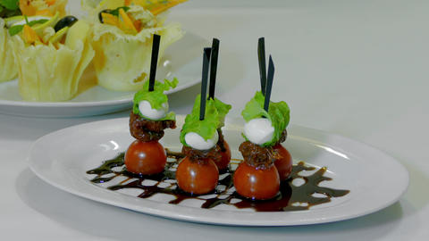 Waiter Puts A Plate Canape With Cherry Tomatoes And Mozzarella On A Table HD Footage