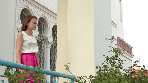 young attractive woman standing on a balcony Footage