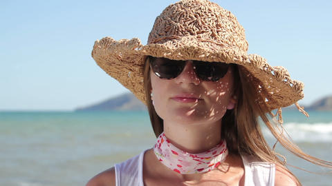 young attractive woman in sunglasses and hat Footage